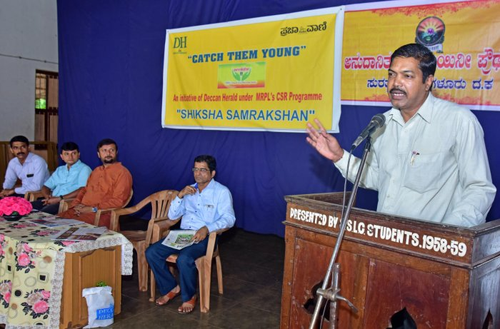 Srisha M Karmaran, Mangalore Refinery and Petrochemicals Limited's (MRPL) assistant manager (CSR), addresses the students after launching 'Catch Them Young', an initiative of Prajavani and DH to inculcate the habit of reading among students, at Vidyadayini High School in Surathkal on Saturday.