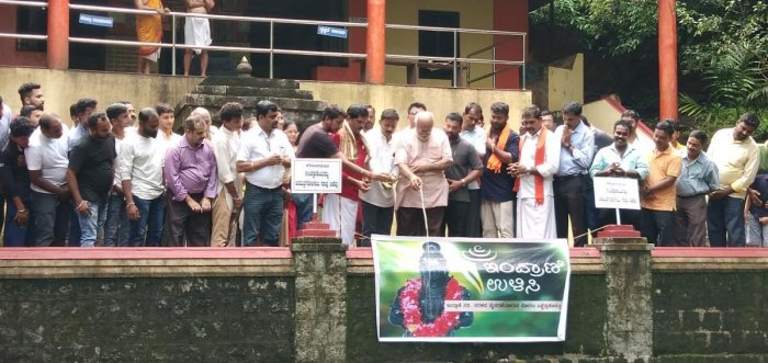 Udupi-based Human Rights Protection Foundation President Dr Ravindranath Shanbhag launches the motorbike rally by pouring milk into the Indrani river at Mukhyaprana Temple in Udupi on Sunday.