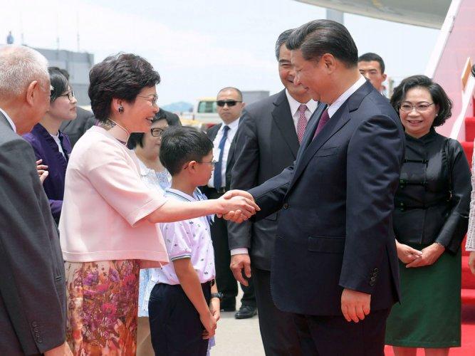 China's President Xi arrives in divided Hong Kong