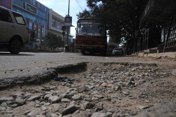 A badly damaged ITPL Main Road. DH FILE PHOTO