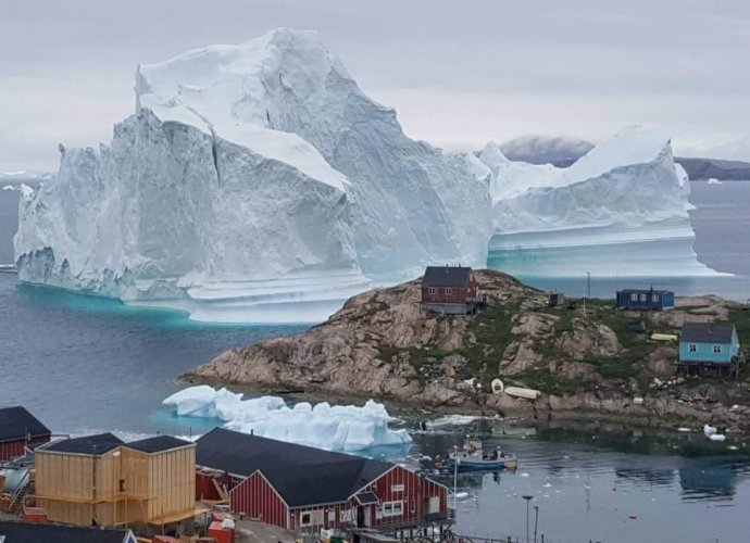As Europe's record-breaking heatwave drifts towards the Arctic it threatens to accelerate the melting of ice in Greenland, which already started earlier than normal this year, climate scientists warned Saturday. (AFP Photo)