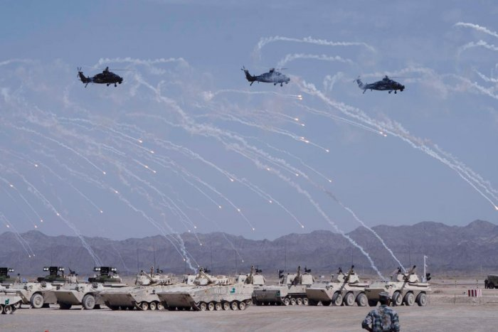 Helicopters and tanks perform during the opening ceremony of three games hosted by PLA part of International Army Games (Reuters File Photo)