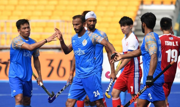 India's SV Sunil (second from left) celebrates with team-mates after scoring against Hong Kong in their men's hockey pool A match on Wednesday. AFP