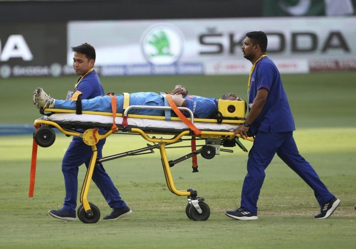 Hardik Pandya is taken out of the field on a stretcher after he fell after bowling a delivery during the one day international cricket match of Asia Cup between India and Pakistan in Dubai. AP/PTI Photo
