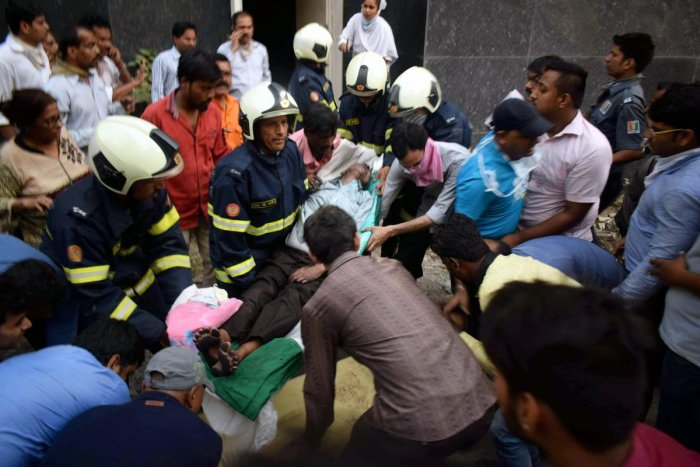 Firefighters conduct rescue after a major fire broke out at ESIC Kamgar Hospital, in Mumbai, Monday, Dec. 17, 2018. At least 6 persons were killed and many patients and visitors suffered injuries in the fire. (PTI Photo)