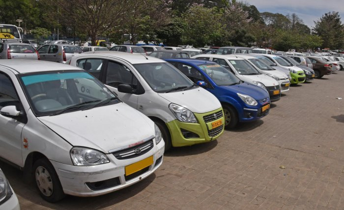 Ola and Uber cabs are parked at Freedom Park in Bengaluru. DH Photo/S K Dinesh