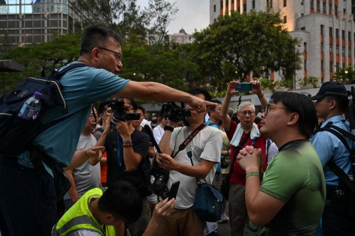 Thousands of masked pro-democracy demonstrators briefly occupied the road outside the office in the semi-autonomous city Sunday night and targeted the building with eggs, projectiles, laser lights and graffiti in a stark rebuke to Beijing's rule. (Photo A