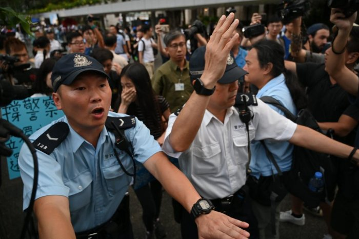 "Hong Kong police on June 22 slammed anti-government protesters for besieging their headquarters, calling the demonstration ""illegal and irrational"" as they vowed to pursue the ringleaders. (AFP Photo)"