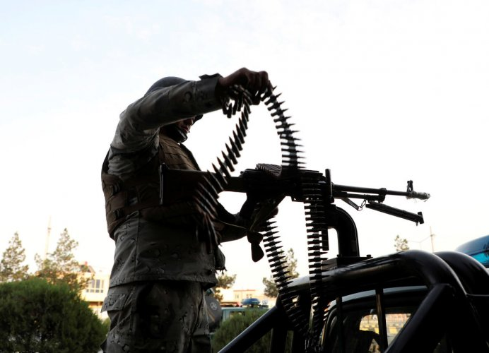 A member of Afghan security forces loads a machine gun near the site of a powerful blast in Kabul, Afghanistan July 28, 2019. REUTERS/Omar Sobhani