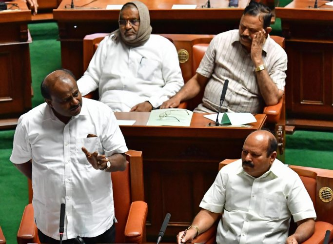 Former chief minister H D Kumaraswamy speaks at the Assembly session in Vidhana Soudha, Bengaluru on Monday. MLAs H K Kumaraswamy, A T Ramaswamy and former minister G T Devegowda are seen. DH Photo