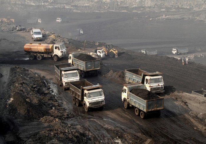 Trucks move in the Mahanadi coal fields, near Talcher town in the eastern state of Odisha, India. (Reuters)