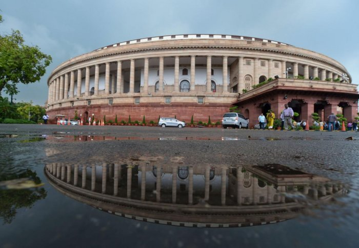 A view of the Parliament House following monsoon rainfall, in New Delhi. PTI