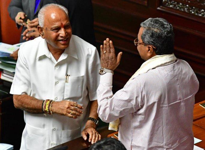 Congress leader Siddaramaiah(right) greets Chief Minister B S Yediyurappa in the Vidhana Soudha after the floor test on Monday. DH Photo/Krishnakumar P S