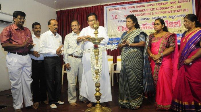 St Mary's Special School Correspondent Fr Matthew Patrick Vas inaugurates a meet organised by Karnataka State Special School Educators and Non-educators Association at Shyamili Hall in Ambalpadi.