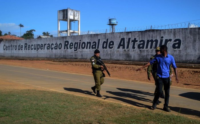 A police officer patrols the surroundings of the Altamira Regional Recovery Centre after at least 57 inmates were killed in a prison riot, in the Brazilian northern city of Altamira, Para State (AFP Photo)