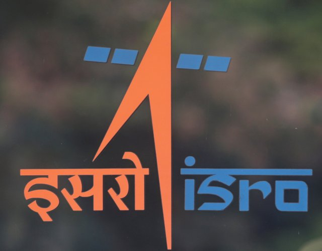 A security guard stands behind the logo of Indian Space Research Organisation (ISRO) at its headquarters in Bengaluru, India. (Reuters Photo)