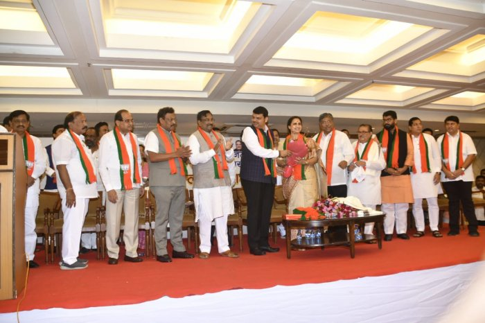 Four MLAs are - Shivendraraje Bhosale, Vaibhav Pichad and Sandeep Naik (all from NCP) and Congressman Kalidas Kolambkar join BJP in an event attended by chief minister Devendra Fadnavis.