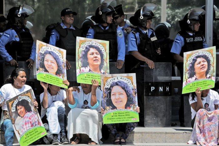 Human rights activists take part in a protest to claim justice after the murdered of indigenous activist leader Berta Cáceres in Tegucigalpa on March 17, 2016.