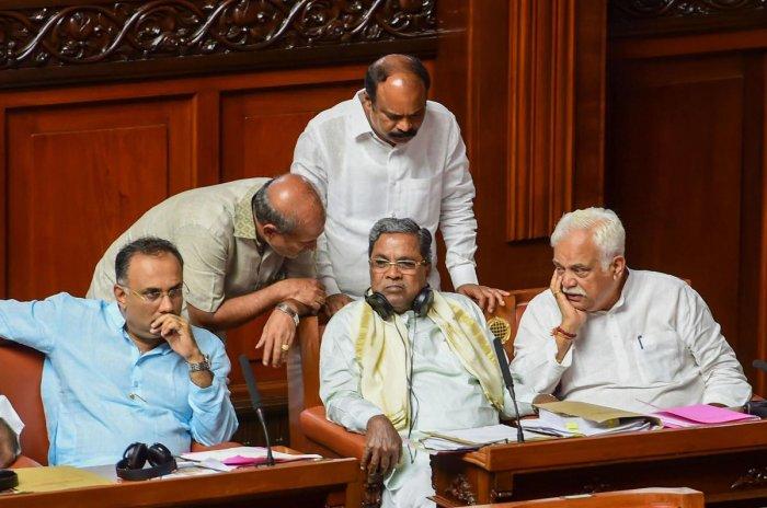 Former chief minister Siddaramaiah, Karnataka Congress chief Dinesh Gundu Rao, and other MLA's (PTI Photo)