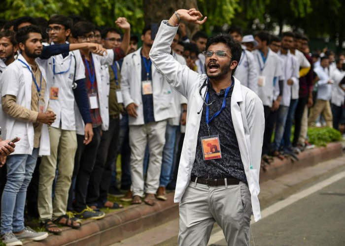 Doctors and students from the Indian Medical Association (IMA) shout slogans as they stage a protest against the National Medical Commission Bill outside Nirman Bhavan in New Delhi, Monday, July 29, 2019. PTI