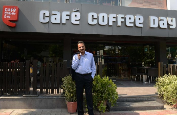 V G Siddhartha, owner of the Café Coffee Day chain, poses for a photograph at one of his coffee shops in Ahmedabad. (AFP File Photo)