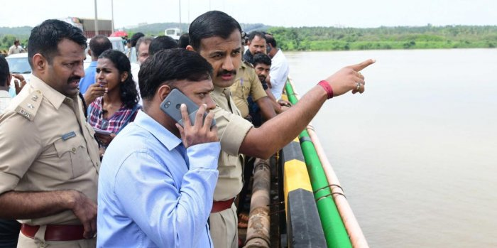 Deputy Commissioner Sasikanth Senthil monitors the search operation near the Nethravathi bridge on the outskirts of Mangaluru city from where coffee czar V G Siddhartha went missing.