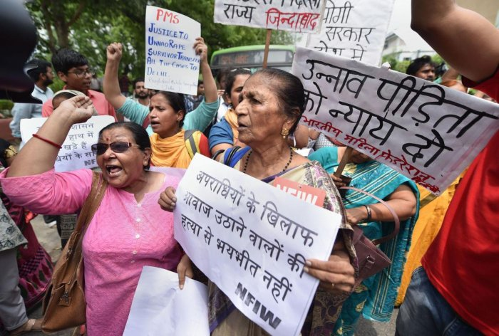 Women activists raise slogans as they stage a protest demonstration over the Unnao case, outside the UP Bhawan. Photo credit: PTI
