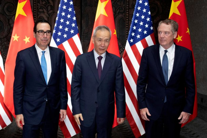 Chinese Vice Premier Liu He with United States Trade Representative Robert Lighthizer and Treasury Secretary Steven Mnuchin pose for photos before holding talks at the Xijiao Conference Center in Shanghai. Photo credit: Reuters