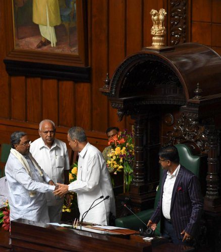 Newly elected speaker of Karnataka Legislative Assembly, Vishweshwar Hegde Kageri being greeted by CM BS Yediyurappa and Former CM Siddaramaiah during the Assembly Session at Vidhan Soudha, in Bengaluru on Wednesday. B H Shivakumar