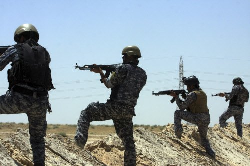 US considers air strikes on Iraq, holds talks with Iran