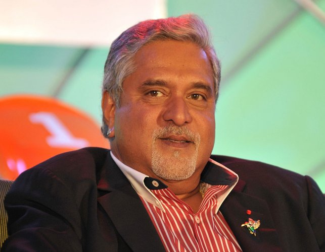 I'm like a football being kicked around by two teams: Mallya