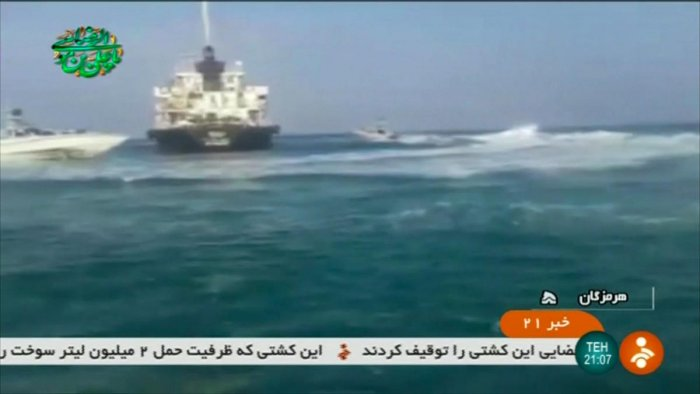 "An image grab taken from a video released by the Iranian Revolutionary Guards on July 18, 2019, reportedly shows the Panamanian-flagged tanker Riah, that was detained by Iran's Revolutionary Guards, in the highly sensitive Strait of Hormuz. - Iran's Revolutionary Guards said they had detained a ""foreign tanker"" and its 12 crew for allegedly smuggling fuel, the latest incident in a tense standoff in the Gulf.  (Photo by STRINGER / IRINN / AFP)"