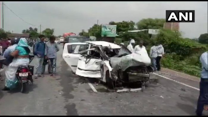 The car had smashed head-on into a truck. (Photo / ANI Twitter)