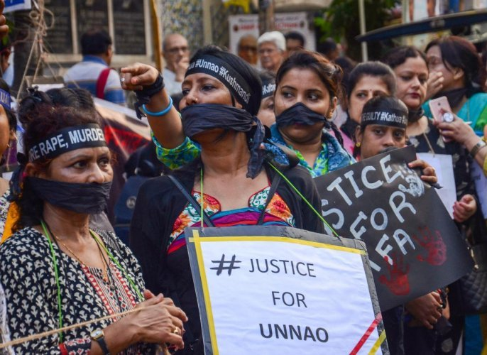 Girl students and women take part in a protest demonstration seeking justice for the victims of Kathua and Unnao rape cases, in Kolkata on Wednesday. PTI Photo