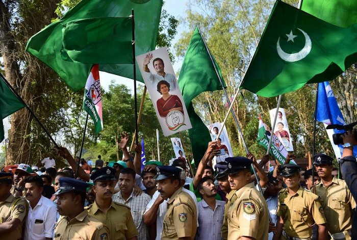 Indian Union Muslim League (IUML) supporters, with green flags, join supporters of Congress as they wave flags. (PTI Photo)