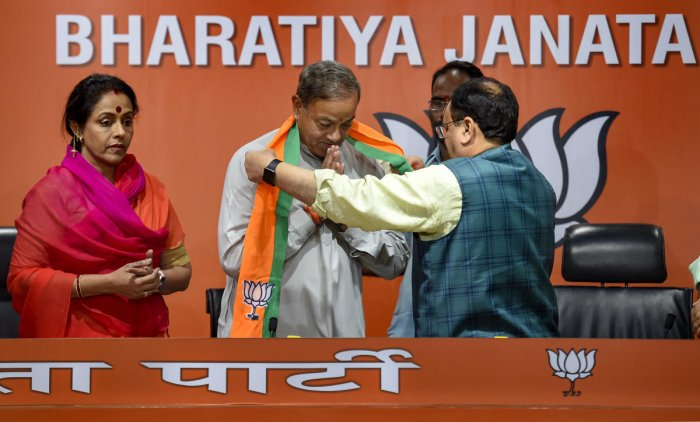 BJP Working President JP Nadda felicitates Sanjya Sinh, as he joins BJP along with his wife Ameeta Sinh, in New Delhi on Wednesday. (PTI Photo)