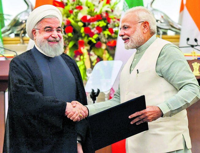 (File) Prime Minister Narendra Modi with Iranian President Hassan Rouhani at the release of a postal stamp commemorating growing economic and trade ties between India and Iran at the Hyderabad House in New Delhi. PTI FILE