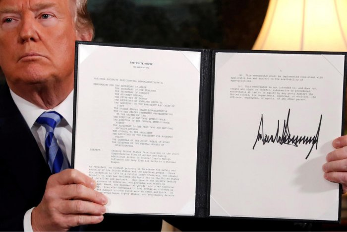 U.S. President Donald Trump holds up a proclamation declaring his intention to withdraw from the JCPOA Iran nuclear agreement after signing it in the Diplomatic Room at the White House in Washington. (REUTERS File Photo)