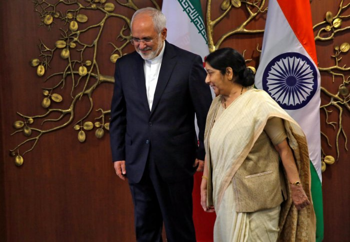 Iran's Foreign Minister Mohammad Javad Zarif and his Indian counterpart Sushma Swaraj walk after a photo opportunity in New Delhi, India, May 28, 2018.