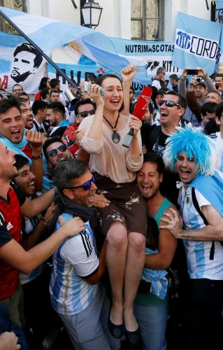 Supporters of the Argentine national soccer team lift a journalist during a gathering in central Moscow. Reuters