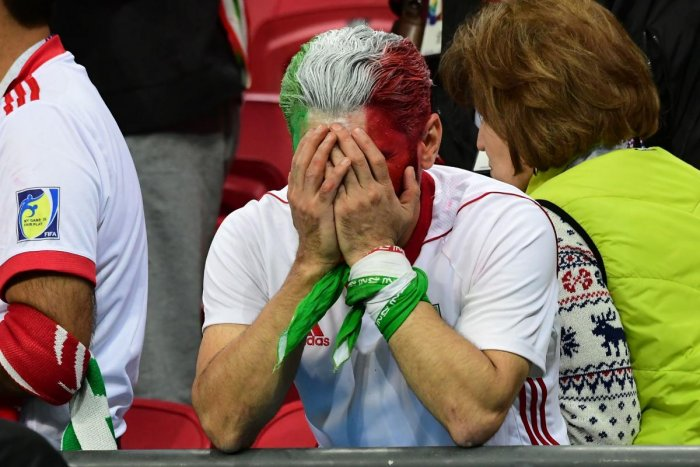 An Iranian fan reacts after the team's defeat to Spain on Wednesday. AFP