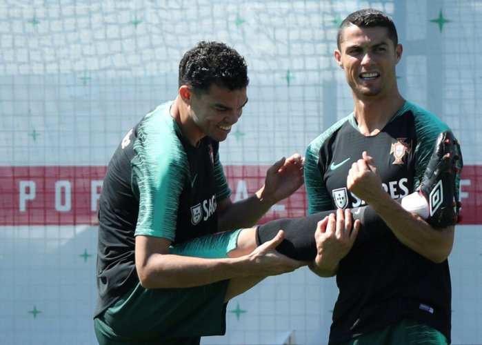 Portugal's Cristiano Ronaldo and Pepe during a training session. REUTERS