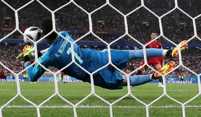 SAFE HANDS: Iran's custodian Alireza Beiranvand makes an excellent save off Portugal's Cristiano Ronaldo penalty during their Group B match in Saransk on Monday. Reuters