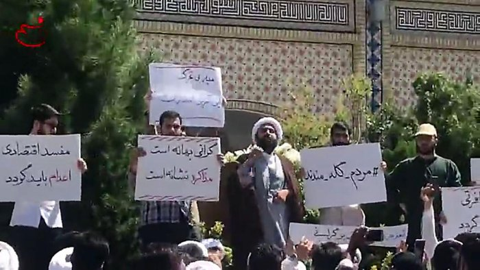 In this video grab made from a video by Nasim News Agency, a cleric speaks to a crowd of protesters demonstrating in Mashhad, in the Khorasan Razavi province, on August 3, 2018. AFP