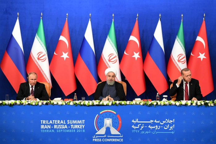 President Vladimir Putin of Russia, Hassan Rouhani of Iran and Tayyip Erdogan of Turkey attend a news conference following their meeting in Tehran, Iran, on September 7, 2018. Reuters