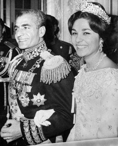 In this file photo taken on December 21, 1959, the Shah of Iran Mohammad Reza Pahlavi and his wife Farah Diba pose for a photograph during their wedding celebrations in Tehran.