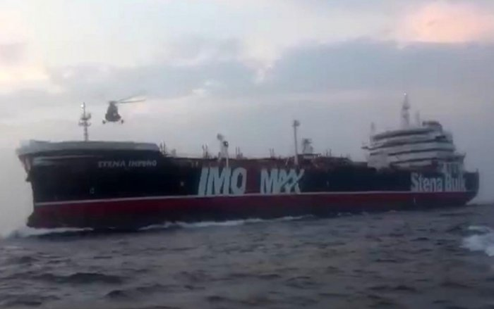 This image grab taken from a video provided by Iran's Revolutionary Guard official website via SEPAH allegedly shows Revolutionary Guard Corps boarding the British-flagged tanker Stena Impero in the Strait of Hormuz. Photo credit: AFP