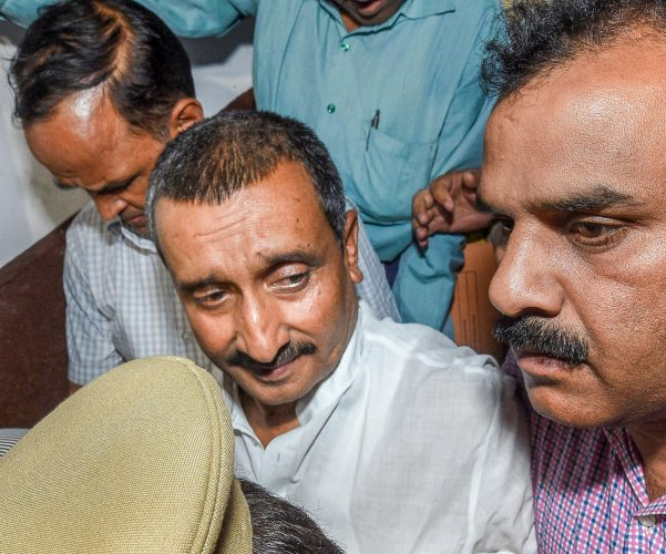 The CBI has booked Uttar Pradesh MLA Kuldeep Singh Sengar and nine others on murder charges in connection with the truck-car collision that left the woman who had accused the legislator of rape critically injured, officials said on Wednesday.