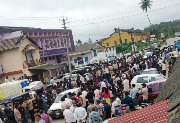 People wait on both sides of the road in Banakal to catch a glimpse of the mortal remains of Cafe Coffee Day founder V G Siddhartha Hegde.