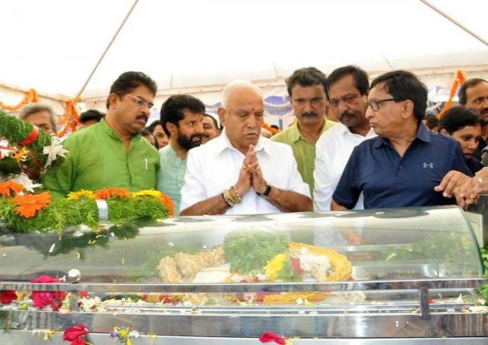 Chief Minister B S Yediyurappa pays homage to V G Siddharth Hegde.